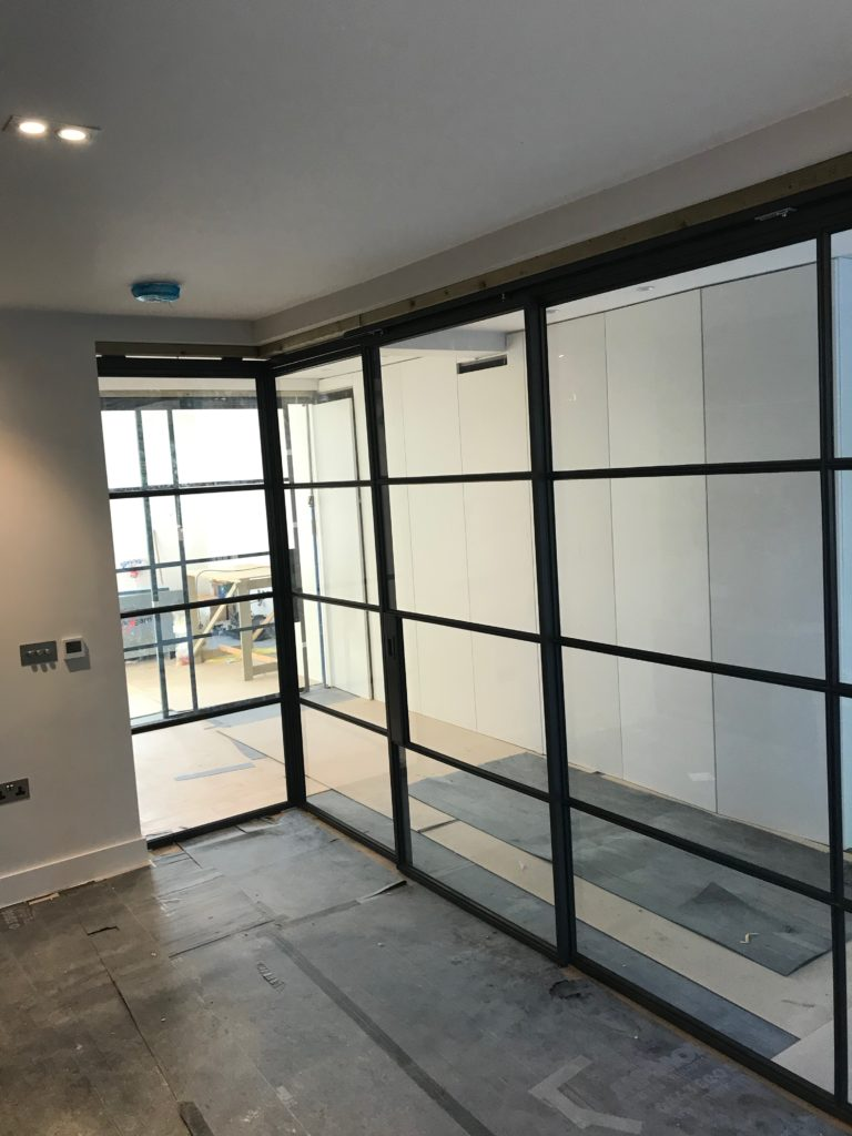 Crittall steel sliding door and Partition by Design Plus London 2
